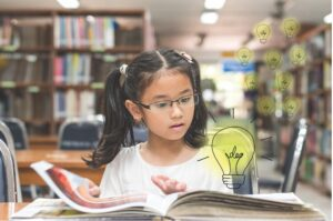 girl looking at lightbulb